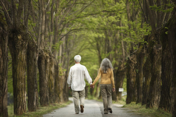 Couple on a tree lined path